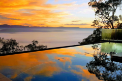 colourful sunset over pool